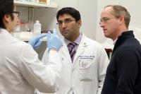 Dr. Satish Nadig, middle, Dr. Carl Atkinson, right, MUSC grad student Danh Tran,