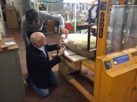 Scientists Examine Stele