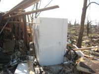 Tornado Shelter Standing Among Ruins