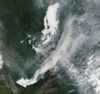 Lake Baikal Wrapped in Fog, Fire, and Smoke