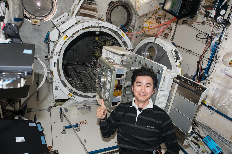 Japanese astronaut Mr. Yugi set up the exposure experiment module ExHAM on the International Space Station.